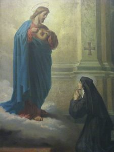 Santa Margarida Maria Alacoque e o Coração de Jesus.